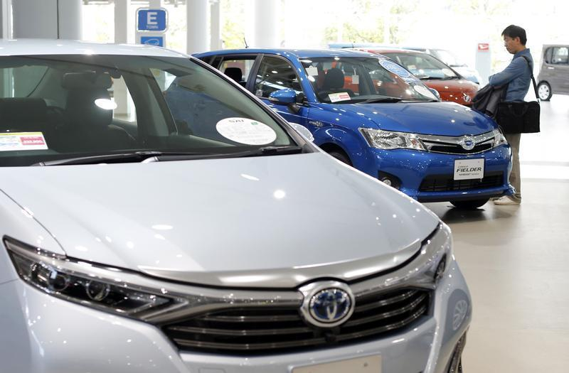 A man looks at Toyota Motor's cars at the company's showroom in Tokyo