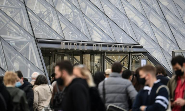 Queues outside the famed Louvre museum in Paris, where people could see the Mona Lisa for the first in months