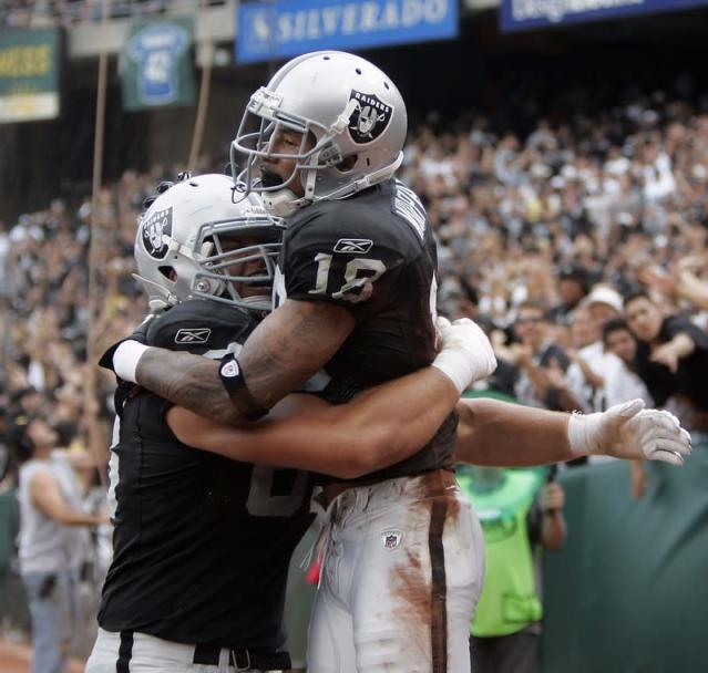 Raiders' Murphy is hugged by Veldheer after scoring a touchdown against the Rams in the second half of their NFL football game in Oakland