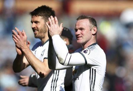 Britain Football Soccer - Burnley v Manchester United - Premier League - Turf Moor - 23/4/17 Manchester United's Wayne Rooney and Michael Carrick applaud fans after the match  Reuters / Andrew Yates Livepic