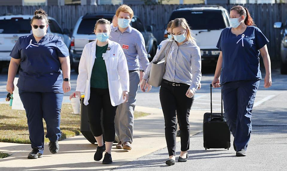 The CVS Health team arrives with the Pfizer COVID-19 vaccine at the Sivercrest Health and Rehabilitation Center in Crestview, Fla. on Dec. 21, 2020. This was one of the first administrations of the vaccine in the state.