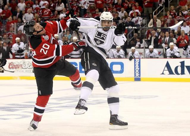 NEWARK, NJ - JUNE 02: Jordan Nolan #71 of the Los Angeles Kings makes contact with Ryan Carter #20 of the New Jersey Devils during Game Two of the 2012 NHL Stanley Cup Final at the Prudential Center on June 2, 2012 in Newark, New Jersey. (Photo by Elsa/Getty Images)