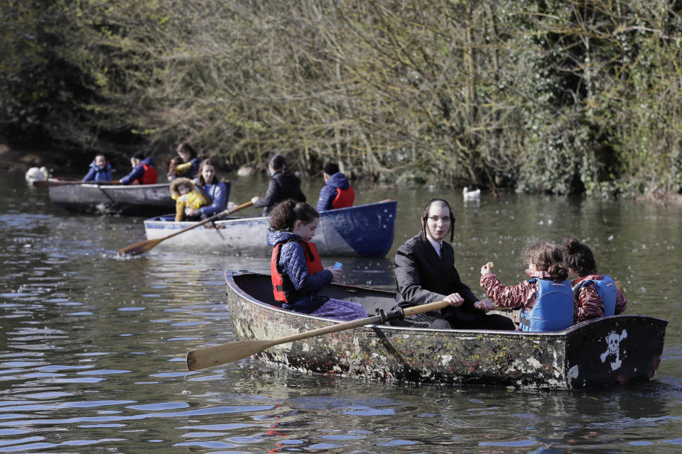Families enjoy a boating lake in Finsbury Park as lockdown measures start to be relaxed in London, Friday, April 2, 2021. (AP Photo/Kirsty Wigglesworth)