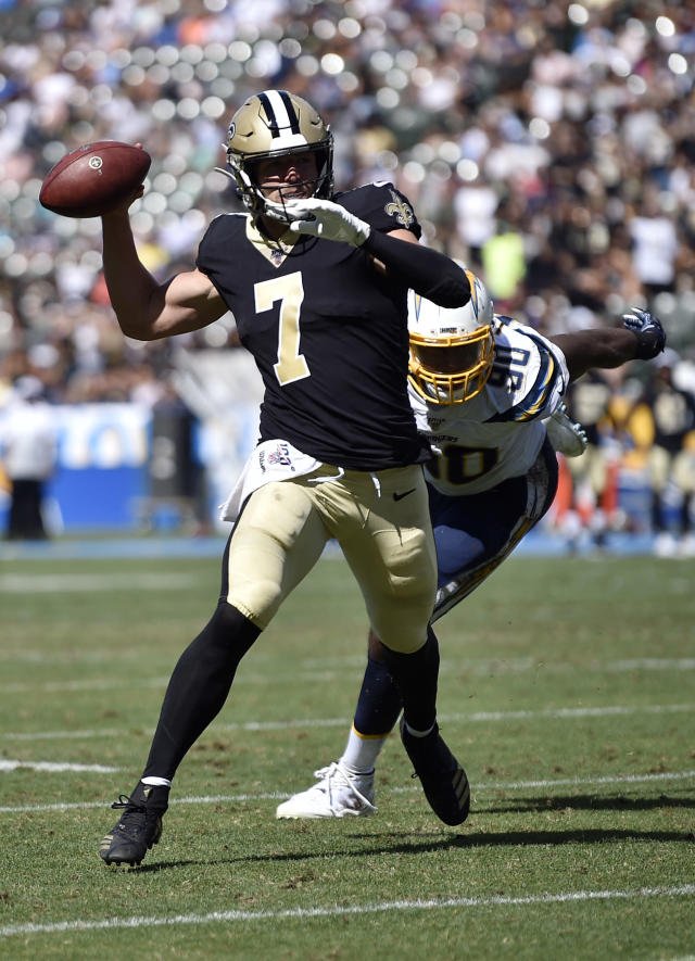 New Orleans Saints quarterback Taysom Hill, left, throws under pressure from Los Angeles Chargers defensive end Anthony Lanier during the second half of a preseason NFL football game Sunday, Aug. 18, 2019, in Carson, Calif. (AP Photo/Kelvin Kuo)