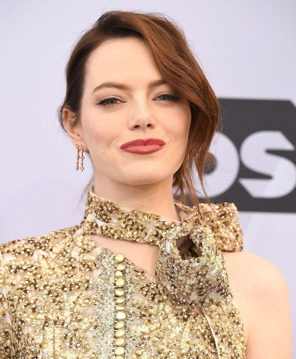 <p>We'll see a lot of deep reds—like Emma Stone's signature look—that mimic the colors of autumn, says Rivera. Think sophisticated deep brunettes mixed with auburn overtones that provide plenty of depth. </p>