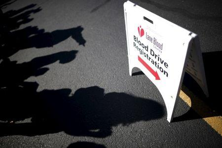 People line up to give blood at a mobile donation station set up following the shooting at Umpqua Community College in Roseburg