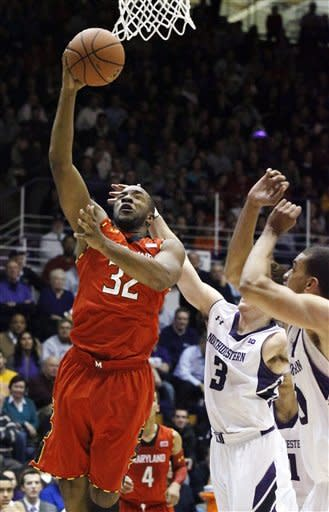 Maryland guard Dezmine Wells (32) scores and is fouled by Northwestern guard Dave Sobolewski (3) during the first half of an NCAA college basketball game, Tuesday, Nov. 27, 2012, in Evanston, Ill. (AP Photo/Charles Rex Arbogast)