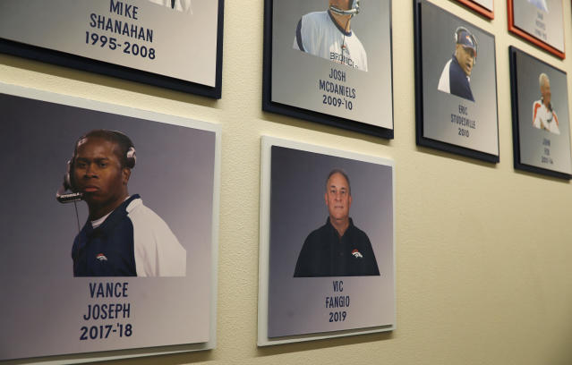 The photograph of the Denver Broncos new head coach Vic Fangio hangs on a wall outside the meeting room where Fangio was introduced at a news conference at the team's headquarters Thursday, Jan. 10, 2019, in Englewood, Colo. (AP Photo/David Zalubowski)
