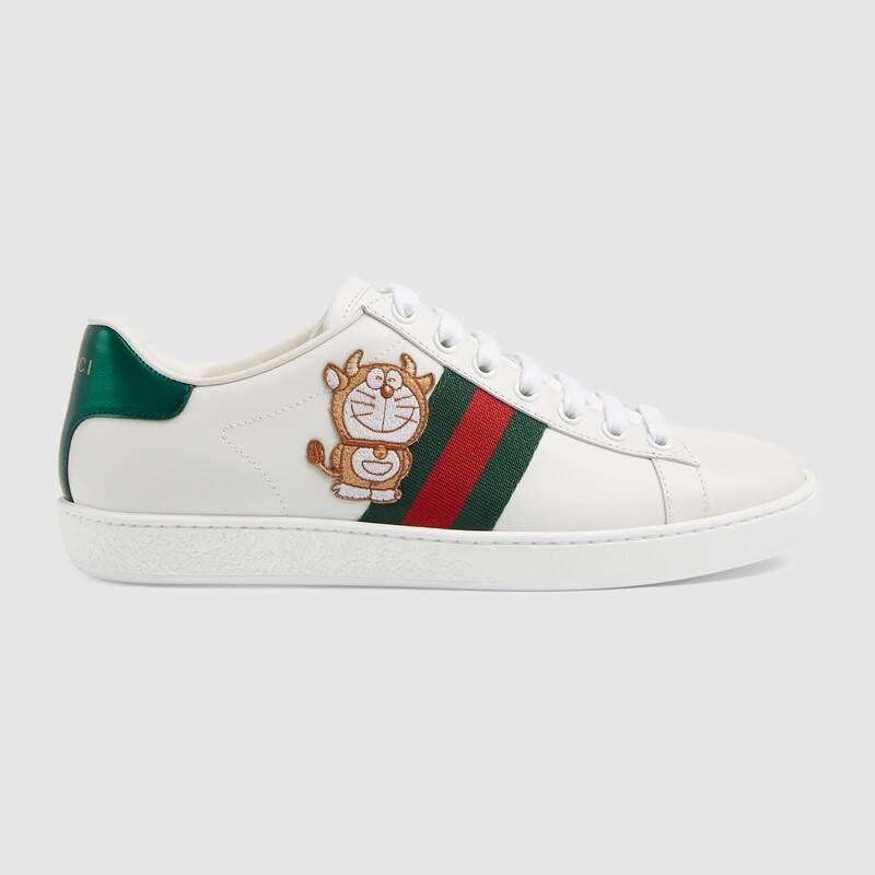 """<p><a class=""""link rapid-noclick-resp"""" href=""""https://go.redirectingat.com?id=127X1599956&url=https%3A%2F%2Fwww.gucci.com%2Fuk%2Fen_gb%2Fpr%2Fwomen%2Fshoes-for-women%2Fsneakers-for-women%2Fdoraemon-x-gucci-womens-ace-sneaker-p-6550310FIU09091&sref=https%3A%2F%2Fwww.townandcountrymag.com%2Fuk%2Fstyle%2Fg35320192%2Fwhat-to-wear-for-an-at-home-lunar-new-year%2F"""" rel=""""nofollow noopener"""" target=""""_blank"""" data-ylk=""""slk:SHOP NOW"""">SHOP NOW</a></p><p>Paired with a mini-dress and some delicate earrings, these Doraemon x Gucci Year of the Ox sneakers will guarantee you put your best foot forward.</p><p>Doraemon x Gucci Ace Sneaker, £520, Gucci.</p>"""