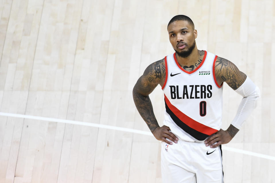 Damian Lillard with his hands on his hips during a Trail Blazers game.