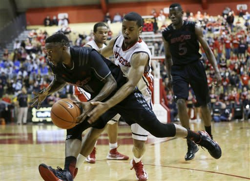 Cincinnati's Cashmere Wright (1) dribbles the ball as Rutgers defender Jerome Seagears (1) tries to make a steal in the first half of an NCAA college basketball game Saturday, Jan. 12, 2013, in Piscataway, N.J. (AP Photo/Mel Evans)