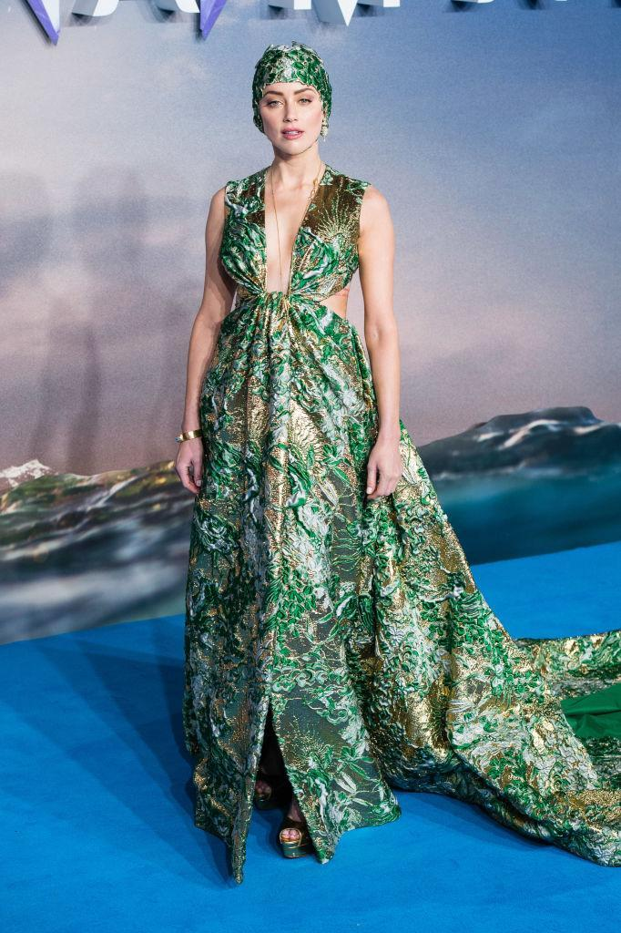 <p>Actress Amber Heard graced the headlines after sporting a Valentino haute couture dress and co-ordinating swim cap for the premiere of 'Aquaman'. To finish the look, she wore a sole pearl earring and Brian Atwood platforms. <em>[Photo: Getty]</em> </p>