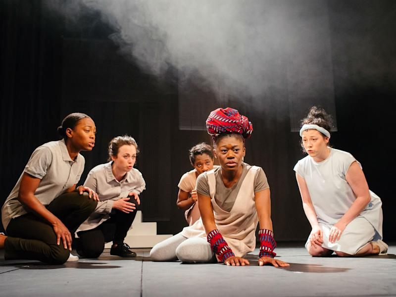 Akiya Henry (centre) as Maddy-Medea with full chorus in the all-female cast of 'Medea' at Bristol Old Vic