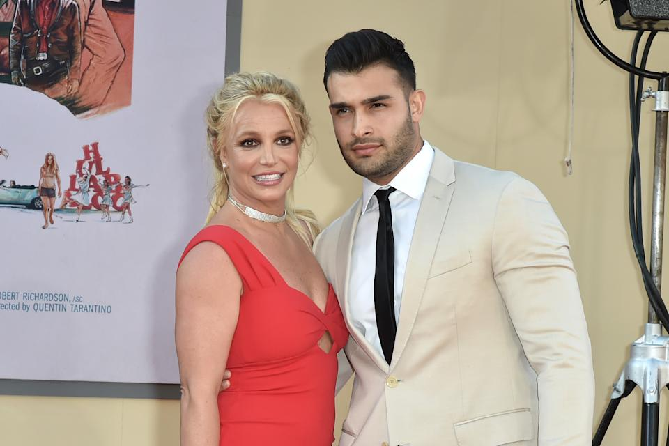 """HOLLYWOOD, CALIFORNIA - JULY 22: Britney Spears and Sam Asghari attend the Los Angeles premiere of """"Once Upon A Time In Hollywood"""" at TCL Chinese Theatre on July 22, 2019 in Hollywood, California. (Photo by David Crotty/Patrick McMullan via Getty Images)"""