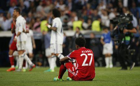 Bayern Munich's David Alaba looks dejected after the match