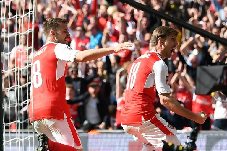 Arsenal's defender Nacho Monreal (R) celebrates scoring their first goal against Manchester City on April 23, 2017