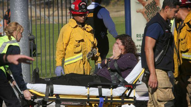 PHOTO: A victim is wheeled away on a stretcher following a shooting that killed 14 people at a social services facility, Dec. 2, 2015, in San Bernardino, Calif. (David Bauman/The Press-Enterprise via AP)