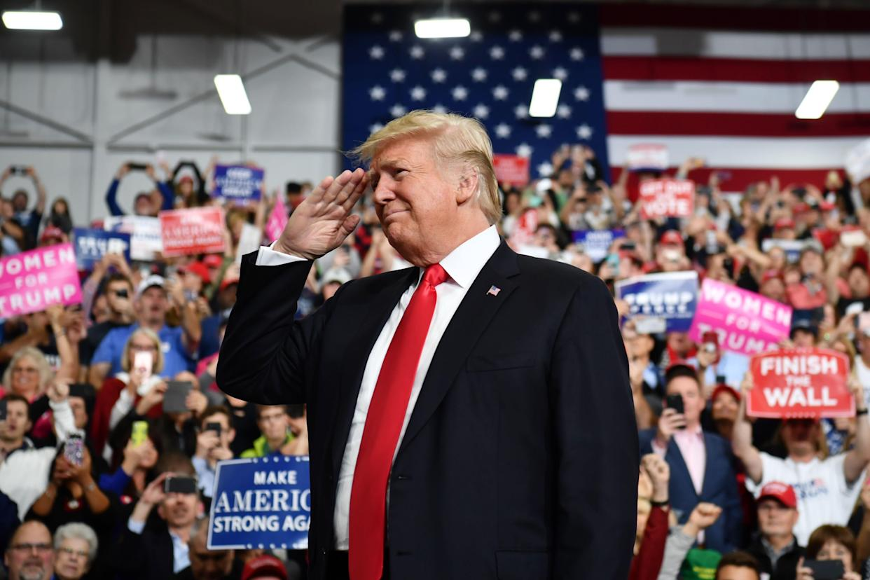 President Trump salutes as he arrives for a campaign rally at Southport High School in Indianapolis, Ind., on Nov. 2, 2018. (Photo by Nicholas Kamm /AFP/Getty Images)
