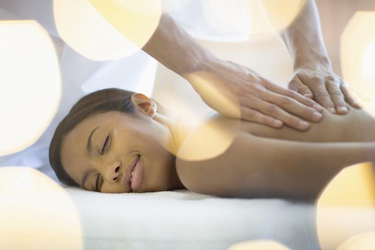 Relax with a massage. [Photo credit: Tom Merton | Getty Images]
