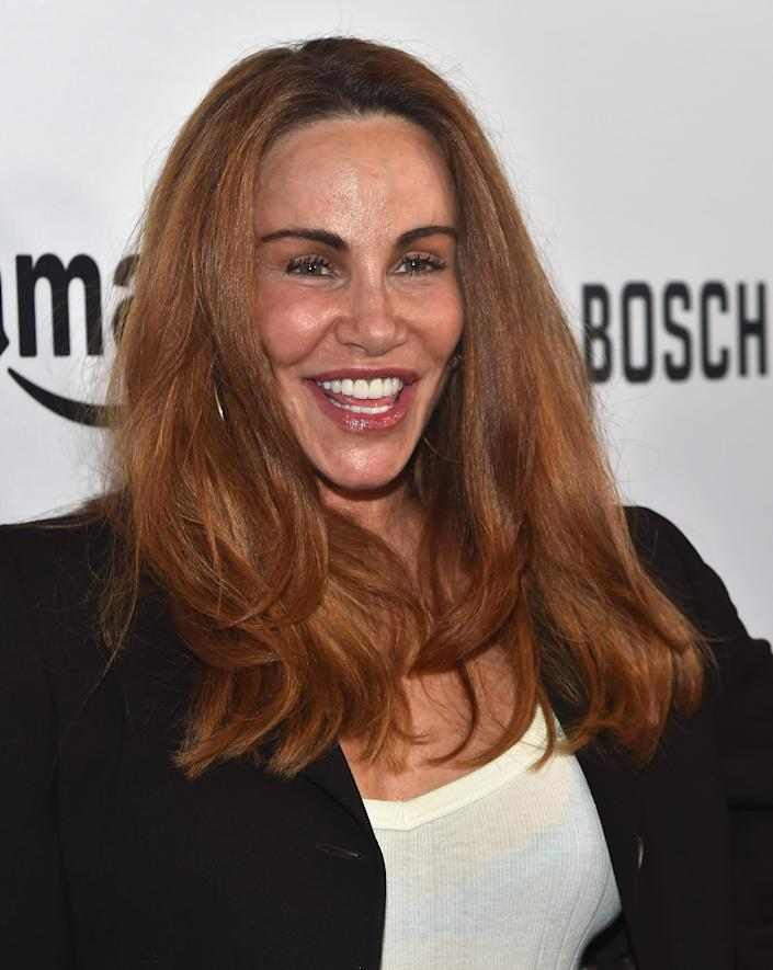 """Tawny Kitaen, known for he role in """"Bachelor Party"""" and starring in several music videos, died Friday. She was 59."""