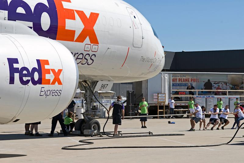 Fairfax County, Virginia, USA - September 14, 2013: Members of the Fairfax County Sheriff's Department pull a FedEx cargo airplane during the annual Dulles Day Plane Pull at Dulles International Airport near Washington, D.C., to help raise money for Special Olympics.