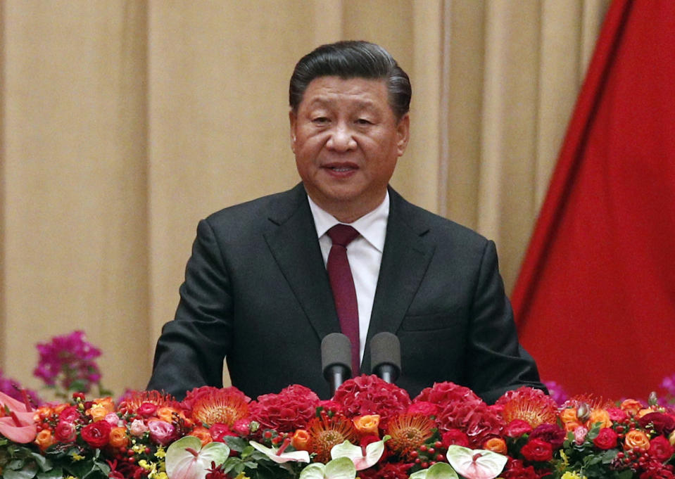 FILE - In this Sept. 30, 2019, file photo, Chinese President Xi Jinping speaks at a dinner marking the 70th anniversary of the founding of the People's Republic of China at the Great Hall of the People in Beijing. BEIJING (AP) — China's ruling Communist Party is holding a key meeting amid a drastically slowing economy, ongoing protests in Hong Kong and pushback abroad against Beijing's global ambitions. (AP Photo/Andy Wong, File)