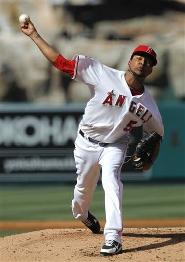 Los Angeles Angels starting pitcher Ervin Santana throws to an Oakland Athletics batter during the second inning of a baseball game in Anaheim, Calif., Tuesday, May 15, 2012. (AP Photo/Chris Carlson)