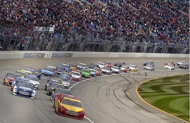 Drivers start the NASCAR Sprint Cup series auto race at Chicagoland Speedway, Sunday, Sept. 15, 2013, in Joliet, Ill. (AP Photo/Warren Wimmer)