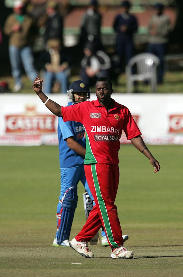 Zimbabwe bowler Brian Vitori dissapointed at being hit for runs during the 4th match of the 5-match cricket ODI series between Zimbabwe and India at Queen's Sports Club in Harare on August 1, 2013. AFP PHOTO / Jekesai Njikizana        (Photo credit should read JEKESAI NJIKIZANA/AFP/Getty Images)
