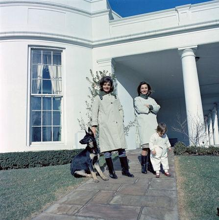 FILE PHOTO --  First Lady Jacqueline Kennedy (L) stands with her sister, Princess Lee Radziwill of Poland, and niece, Anna Christina Radziwill, on the walkway outside the Oval Office with the Kennedy family dog Clipper at the White House in Washington, D.C., January 15, 1963.   Courtesy Cecil Stoughton/JFK Library/Handout via REUTERS