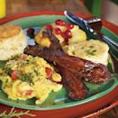 """<p>Hearty scrambled eggs get a punch of flavor with fresh herbs and <a href=""""https://www.myrecipes.com/ingredients/fresh-tomato-recipes"""" rel=""""nofollow noopener"""" target=""""_blank"""" data-ylk=""""slk:tomato"""" class=""""link rapid-noclick-resp"""">tomato</a>.</p>"""