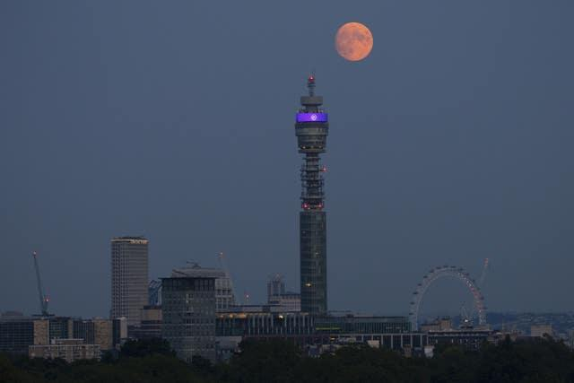 The moon rises over the BT Tower in central London (Hollie Adams/PA)