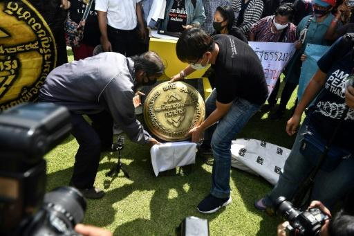 Thai activists unveil a replica of bronze plaque marking the anniversary of the 1932 revolution. The original mysteriously vanished in 2017