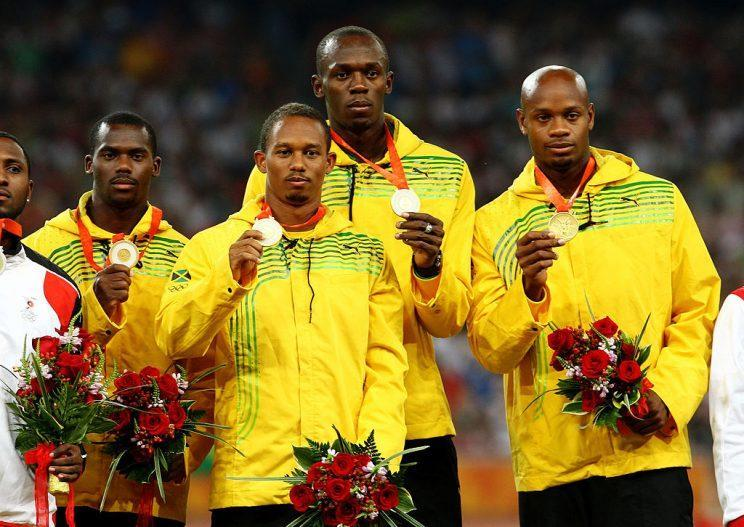 BEIJING - AUGUST 23: (L to R) Nesta Carter, Michael Frater, Usain Bolt and Asafa Powell of Jamaica receive their gold medals during the medal ceremony for the Men's 4 x 100m Relay Finalheld at the National Stadium on Day 15 of the Beijing 2008 Olympic Games on August 23, 2008 in Beijing, China. (Photo by Julian Finney/Getty Images)