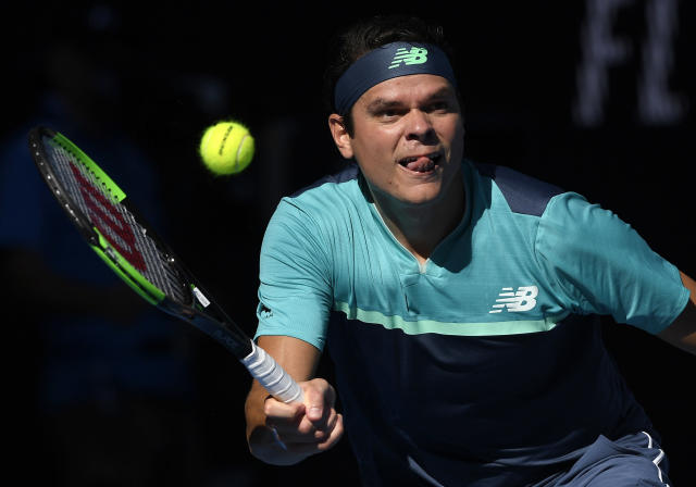 Canada's Milos Raonic makes a forehand return to France's Lucas Pouille during their quarterfinal match at the Australian Open tennis championships in Melbourne, Australia, Wednesday, Jan. 23, 2019. (AP Photo/Andy Brownbill)