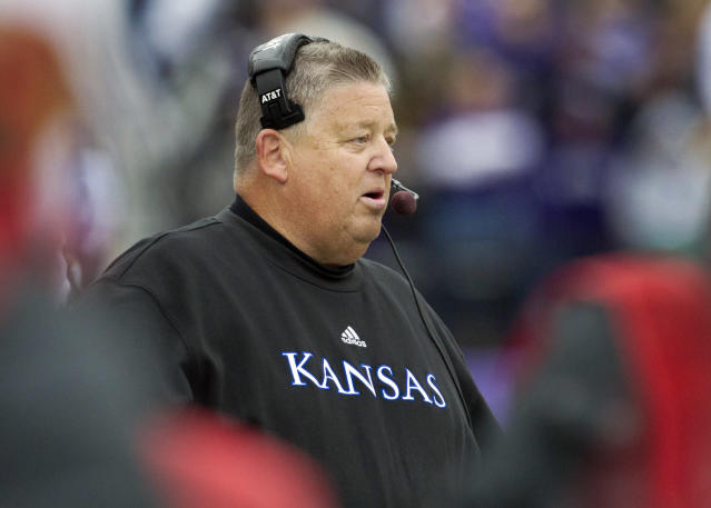Kansas coach Charlie Weis watches from the sideline during the first half of an NCAA college football game against the Kansas State in Manhattan, Kan., Saturday, Oct. 6, 2012. (AP Photo/Orlin Wagner)