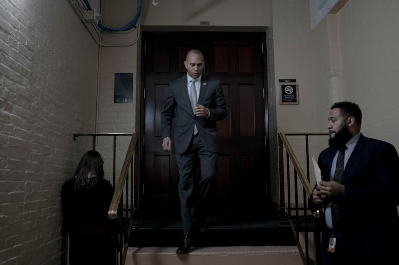 Democratic Caucus Chairman Hakeem Jeffries (D-N.Y.) leaves a meeting with the House Democratic Caucus in the basement of the Capitol in Washington, D.C., on Dec. 17, 2019. | Gabriella Demczuk for TIME