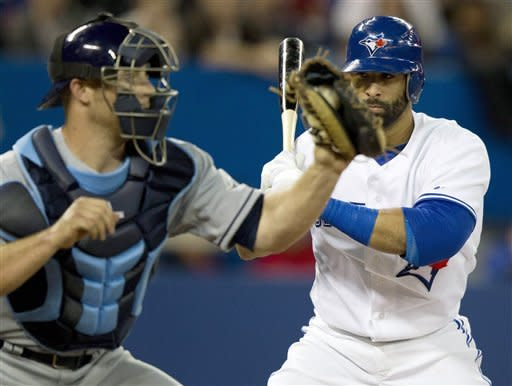 Toronto Blue Jays Jose Bautista, right, watches Tampa Bay Rays catcher Chris Gimenez catch a pitch out in an attempt to throw out a leading runner during third inning AL action in Toronto on Tuesday April 17, 2012. (AP Photo/The Canadian Press, Frank Gunn)