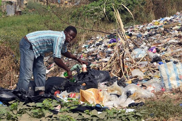 """A scavenger picks leftover from a dump along Lagos Ibadan expressway -- """"The terrible state of Nigeria has become normalised"""", says rapper Falz (AFP Photo/PIUS UTOMI EKPEI)"""