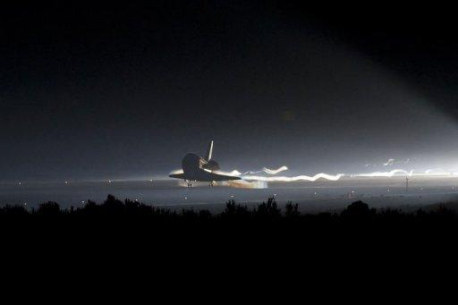 In this image released by NASA, the space shuttle Atlantis lands at Kennedy Space Center in Florida. The shuttle Atlantis cruised home for a final time Thursday, ending its last mission to the International Space Station and closing a 30-year chapter in American space exploration