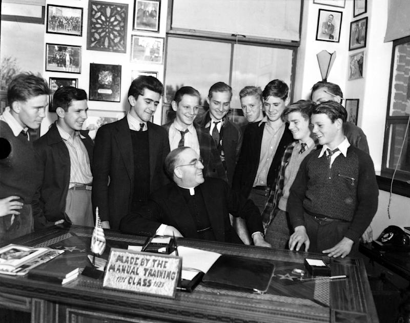 This photo from 1942 which was provided by Boys Town, shows Boys Town founder Father Edward Flanagan, center, being surrounded by his charges. Omaha Archbishop George Lucas has opened, Monday, Feb. 27, 2012, the cause for the beatification and canonization of Boys Town founder Father Edward Flanagan.(AP Photo/Boys Town)