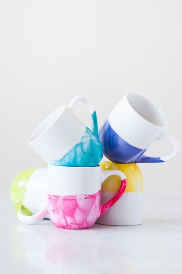 """<p>A <a rel=""""nofollow"""" href=""""http://www.drozthegoodlife.com/health-articles/g163/health-benefits-coffee-studies/"""">coffee</a> cup doesn't need to scream """"#1 Mom!"""" to show how much you care. These mugs — made by dipping them into pretty <a rel=""""nofollow"""" href=""""http://www.drozthegoodlife.com/beauty/hair-nails/tips/g342/spring-nail-polish-colors/"""">spring nail polish</a> colors — are even more special.</p><p>Get the directions from <a rel=""""nofollow"""" href=""""http://www.thesweetestoccasion.com/2015/08/diy-marble-dipped-mugs/"""">The Sweetest Occasion</a>.</p>"""