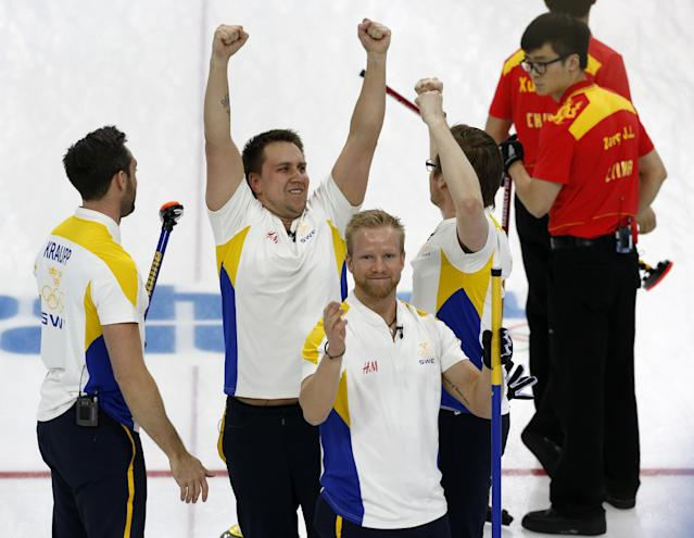 Sweden's player from left, Sebastian Kraup, Fredrik Lindberg, Niklas Edin, and Viktor Kjaell celebrate their victory over China in the men's curling bronze medal game at the 2014 Winter Olympics, Friday, Feb. 21, 2014, in Sochi, Russia. (AP Photo/Robert F. Bukaty)