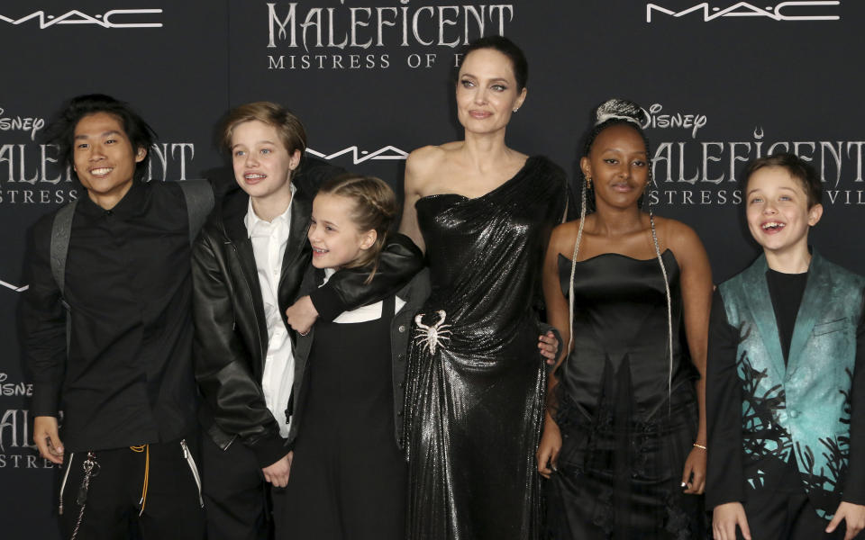"""CORRECTS TO PAX JOLIE-PITT, NOT MADDOX JOLIE-PITT - Angelina Jolie, third right, and her children, from left, Pax Jolie-Pitt, Shiloh Jolie-Pitt, Vivienne Jolie-Pitt, Zahara Jolie-Pitt and Knox Jolie-Pitt arrive at the world premiere of """"Maleficent: Mistress of Evil"""" on Monday, Sept. 30, 2019, at the El Capitan Theatre in Los Angeles. (Photo by Willy Sanjuan/Invision/AP)"""
