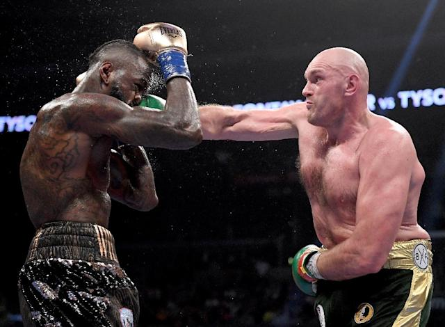Tyson Fury punches Deontay Wilder in the seventh round of their heavyweight title bout -- afterwards, both accepted the controversial split-decision draw (AFP Photo/Harry How)