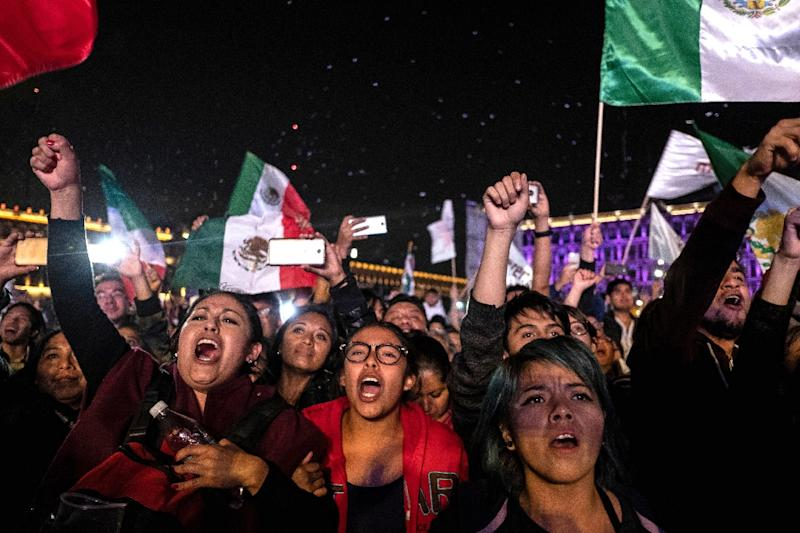 Supporters of the presidential candidate for Andres Manuel Lopez Obrador, celebrate his landslide victory (AFP Photo/Guillermo Arias)