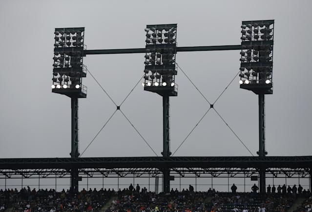 Stadium lights go out at Comerica Park to delay the game in the second inning during Game 3 of the American League baseball championship series between the Boston Red Sox and the Detroit Tigers Tuesday, Oct. 15, 2013, in Detroit. (AP Photo/Charlie Riedel)