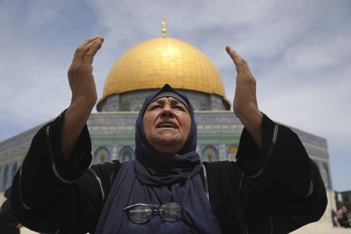A Palestinian prays during the last Friday prayers of the Muslim holy month of Ramadan at the Dome of the Rock Mosque in the Al Aqsa Mosque compound in the Old City of Jerusalem, Jerusalem, Friday, May 7, 2021. (AP Photo/Mahmoud Illean)