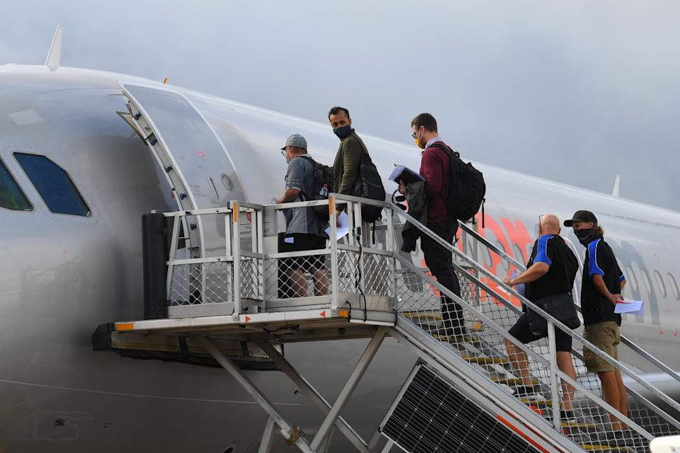 Passengers are seen boarding a Jetstar flight to Sydney at Melbourne Airport. Source: AAP
