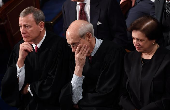 <p>From left: U.S. Supreme Court justices John Roberts, Stephen Breyer and Elena Kagan look on as Trump delivers the State of the Union address on Jan. 30. (Photo: Saul Loeb/AFP/Getty Images) </p>